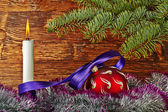 Christmas decoration. Red ball, violet ribbon, fir-tree, candle — ストック写真