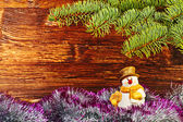 Christmas decoration. Snowman, tinsel and fir-tree. Selective fo — Photo
