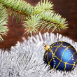 Christmas decoration. Blue ball, tinsel and fir-tree — Foto de Stock