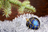 Christmas decoration. Blue ball, tinsel and fir-tree — Stock Photo