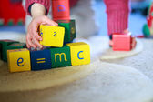 Child playing with building blocks — Stock Photo