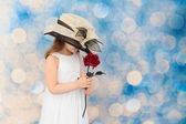 Little girl holding a rose — Stock Photo