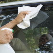 Cleaning car window — Stock Photo #12319982