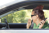 Mid aged woman sneeze in the car — Stock Photo