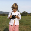 Young boy with vintage photo camera — Stock Photo
