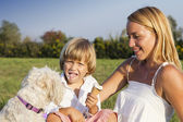 Mother, son and cute dog outdoors — Stock Photo