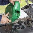 Adding oil in vehicle — Stock Photo #13208348