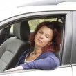 Tired woman driver sleeps in the car — Stock Photo #13209815