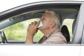 Sneezing man in the car — Stock Photo