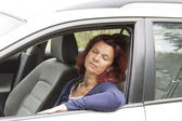 Tired woman driver sleeps in the car — Stock Photo