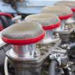 Air filters in vintage racing car — Stock Photo #13772385
