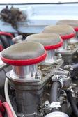 Air filters in vintage racing car — Stock Photo