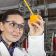 Cute chemist working in laboratory — Stock Photo
