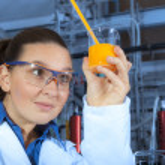 Cute chemist working in laboratory — Stock Photo #14454489