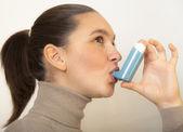 Cute girl with asthma inhalator — Stock Photo