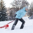 Smiling cute girl pulling sled — Stock Photo