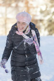 Cute woman on the snow — Stock Photo