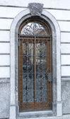 Door protected with iron lattice — Stock Photo