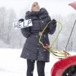 Cute girl needs help on road — Stock Photo #18883519