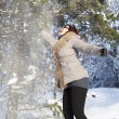 Stock Photo: Mid aged cute womplaying with snow