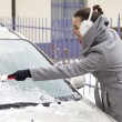 Removing snow and ice from the car — Stock Photo