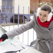 Removing snow and ice from car — Stock Photo #19960577