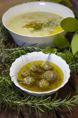 Artichoke hearths and asparagus creamy soup — Stock Photo