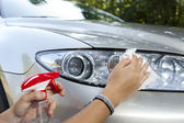 Cleaning car on sunny morning — Stock Photo