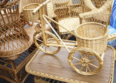 Wicker bicycle and furniture — Stock Photo
