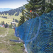 Protective network to the alpine skiing track — Stock Photo