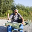 Friendly senior RC modeller and his new plane model — Stock Photo