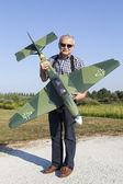 Friendly senior RC modeller and his new plane model — Stock Photo