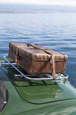 Old suitcase on vintage sport car — Stock Photo