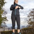 Runner woman checking  time and pulse rate — Stock fotografie