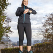 Runner woman checking  time and pulse rate — Stock Photo