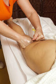 Woman receiving a professional massage and lymphatic drainage -various techniques demonstration — Stock Photo