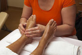 Professional relaxing foot massage, various techniques — Stock Photo