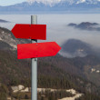 Red mountain guidepost along alpine pathway — Stock Photo #37343533