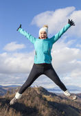 Young women joyfully jumping outdoors — Stock Photo