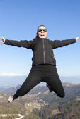 Young sportive women joyfully jumping in the mountains — Stock Photo