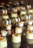 Close up of tasty Fruits of the sea canapes — Stock Photo