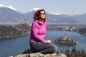 Cute woman sunbathing by the Lake Bled — Stock Photo
