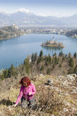 Cute brunette middle aged woman in mountains by Lake Bled — Stock Photo