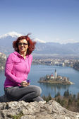 Lake Bled and woman picking flowers — Stock Photo