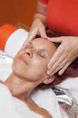Cute woman gets professional facial massage, lymphatic drainage — Stock Photo