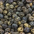 Black peppercorn macro — Stock Photo #16778011