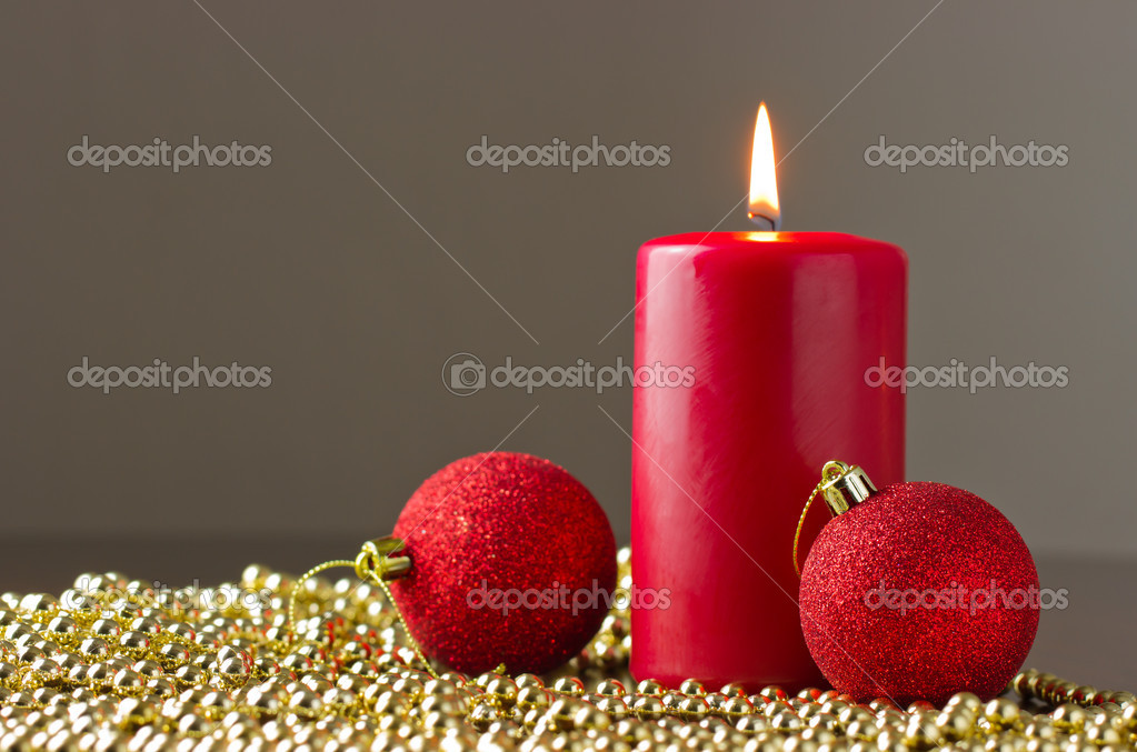 Candle with christmas ball — Stock Photo #16852481