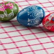 Easter eggs an checked textile — Stock Photo
