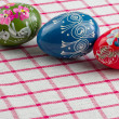 Easter eggs an checked textile - Stock Photo