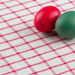 Easter eggs an red checked textile - Stock Photo